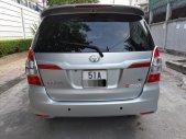 Gia đình cần bán xe innova E 2014 màu bạc giá 430 triệu tại Tp.HCM