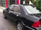 Bán Ford Laser GHIA 1.8 MT sản xuất năm 2003, màu đen, 134 triệu giá 134 triệu tại Hà Nội
