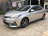 Cần bán gấp Toyota Corolla altis 1.8G đời 2017, màu bạc giá cạnh tranh 69.000km giá 710 triệu tại Tp.HCM