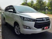 Bán xe Toyota Innova 2.0E sản xuất 2018, màu trắng Biển Sg , mới chạy 64.000km - hỗ trọ vay 70% giá 760 triệu tại Tp.HCM