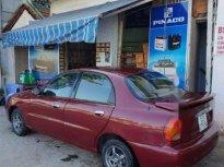 Gia đình bán Daewoo Lanos đời 2002, màu đỏ giá 80 triệu tại Tiền Giang