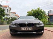 Cần bán BMW 3 Series 320i đời 2013, màu nâu, xe nhập   giá 880 triệu tại Tp.HCM