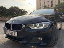Cần bán lại xe BMW 320i năm sản xuất 2013, màu đen, nhập khẩu giá 889 triệu tại Hà Nội