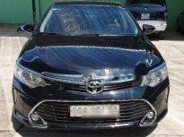 Cần bán Toyota Camry 2.0E năm 2017, màu đen, 950 triệu giá 950 triệu tại Đồng Tháp