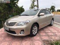 Bán gấp Toyota Corolla altis 1.8G AT sản xuất 2013, màu vàng còn mới, giá 580tr giá 580 triệu tại Hà Nội