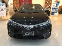 Cần bán gấp Toyota Corolla Altis sản xuất năm 2019, màu đen, giá tốt giá 180 triệu tại Tp.HCM