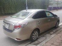 Chính chủ bán xe Toyota Vios E sản xuất 2015, màu vàng cát giá 420 triệu tại Hà Nội