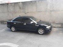 Bán xe Mazda 323 1.6 MT năm sản xuất 2000, màu đen giá 158 triệu tại Tp.HCM
