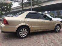 Bán Ford Laser 1.8 AT sản xuất 2005, model 2006, biển TP, màu vàng cát, nội thất màu ghi giá 255 triệu tại Hà Nội