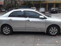 Cần bán xe Toyota Corolla Altis 1.8 đời 2013, màu bạc chính chủ giá 550 triệu tại Hà Nội