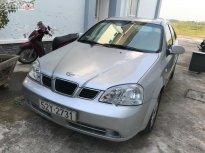 Bán xe Daewoo Lacetti EX Sx 2005, số tay, máy xăng, màu bạc, nội thất màu xám, odo 80000 km giá 165 triệu tại Long An