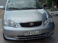 Cần bán lại xe Toyota Corolla altis sản xuất 2002, màu bạc xe gia đình giá 265 triệu tại Tây Ninh