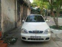 Cần bán gấp Daewoo Lanos sản xuất 2005, màu trắng giá 110 triệu tại Tp.HCM