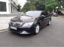 Bán Toyota Camry 2.0E sản xuất năm 2013, màu đen xe gia đình giá 725 triệu tại Hà Nội