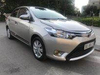Cần bán xe Toyota Vios E đời 2016, màu vàng giá 568 triệu tại Hà Nội