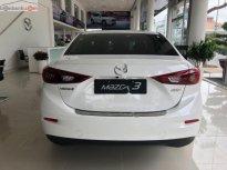 Bán Mazda 3 1.5 AT sản xuất 2019, màu trắng  giá 659 triệu tại Tp.HCM