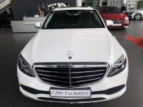 Bán xe Mercedes C200 Exclusive sản xuất năm 2019, màu trắng giá 1 tỷ 709 tr tại Tp.HCM