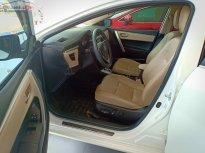 Cần bán lại xe Toyota Corolla altis 1.8G đời 2015, màu trắng giá 640 triệu tại Khánh Hòa