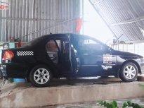 Cần bán xe Kia Spectra đời 2004, màu đen giá 117 triệu tại Bình Định