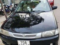 Bán Mazda 323 năm 2000, màu đen, nhập khẩu nguyên chiếc giá 86 triệu tại Tây Ninh
