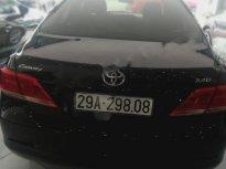 Bán xe Toyota Camry 2.4G đời 2011, màu đen chính chủ giá 618 triệu tại Hà Nội