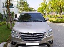 Cần bán xe Toyota Innova 2.0E năm 2015, màu vàng giá 425 triệu tại Hà Nội