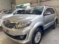 Cần bán Toyota Fortuner 2.7AT đời 2013, màu bạc giá 670 triệu tại Tp.HCM
