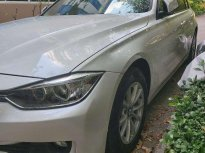 Bán BMW 320i sản xuất năm 2012, màu trắng, nhập khẩu  giá 750 triệu tại Tp.HCM