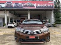 Bán xe Toyota Corolla altis 1.8G đời 2014, màu nâu giá 590 triệu tại Tp.HCM