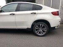 Chính chủ cần bán xe BMW X6 3,5AT 2009 màu trắng, full option giá 660 triệu tại Tp.HCM
