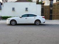 Cần bán gấp xe Mazda 6 2.0 AT 2016 tự động, màu trắng giá 640 triệu tại Tp.HCM